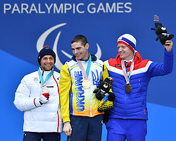 DAVIET Benjamin FRA LW2, REPTYUKH Ihor UKR LW8, OLSRUD Hakon NOR LW8, ParaSkiDeFond, Para Nordic Skiing, 20km, Podium at  the PyeongChang2018 Winter Paralympic Games, South Korea.
