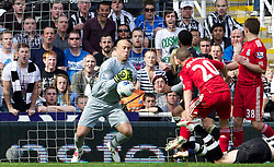 NEWCASTLE-UPON-TYNE, ENGLAND - Sunday, April 1, 2012: Liverpool's goalkeeper Jose Reina slips the ball, which later leads to his sending off, during the Premiership match against Newcastle United at St James' Park. (Pic by Vegard Grott/Propaganda)