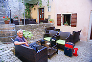 a mature European tourist at Motovun (Montona) is a village in central Istria, Croatia.
