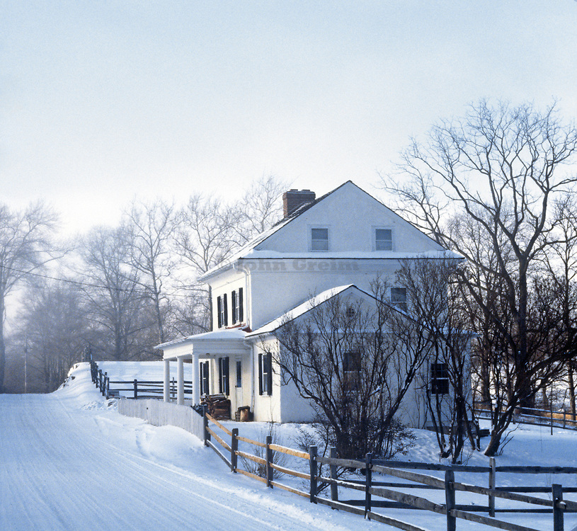 Snow covered rural house and road in winter, Chester County, Pennsylvania