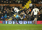 Fulham defender Ashley (Jazz) Richards climbing all over Sheffield Wednesday striker Lucas Joao during the Sky Bet Championship match between Fulham and Sheffield Wednesday at Craven Cottage, London, England on 2 January 2016. Photo by Matthew Redman.