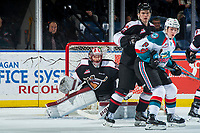 KELOWNA, CANADA - MARCH 7: Jack Cowell #8 of the Kelowna Rockets looks for the pass ahead of Bowen Byram #44 and David Tendeck #30 of the Vancouver Giants  on March 7, 2018 at Prospera Place in Kelowna, British Columbia, Canada.  (Photo by Marissa Baecker/Shoot the Breeze)  *** Local Caption ***