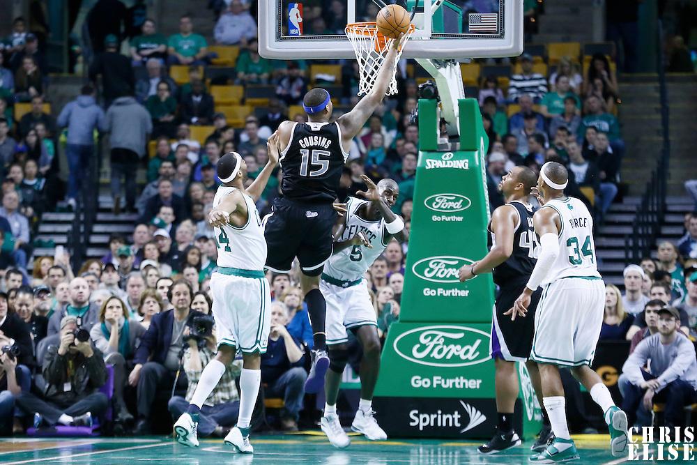 30 January 2013: Sacramento Kings center DeMarcus Cousins (15) goes for the layup over Boston Celtics power forward Kevin Garnett (5) during the Boston Celtics 99-81 victory over the Sacramento Kings at the TD Garden, Boston, Massachusetts, USA.