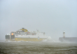 © Licensed to London News Pictures. 15th January 2018. Newhaven, UK. A Transmanche cross-channel ferry struggles to leave the port of Newhaven as strong winds across the South Coast whip up huge waves in the English Channel. Photo credit: Peter Cripps/LNP