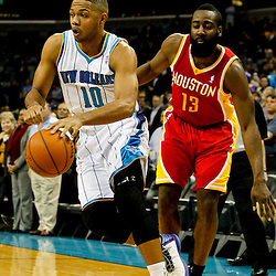 Jan 9, 2013; New Orleans, LA, USA; New Orleans Hornets shooting guard Eric Gordon (10) drives past Houston Rockets shooting guard James Harden (13) during the first quarter of a game at the New Orleans Arena. Mandatory Credit: Derick E. Hingle-USA TODAY Sports