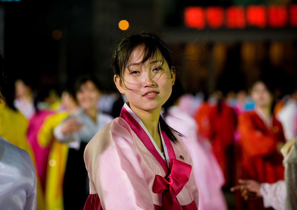 -What is the criteria for beauty in North Korea?<br /> -Mr Eric, a woman should have big eyes, a high nose, a small mouth and a white skin, and she<br /> should not be skinny. Women in North Korea are truly beautiful flowers.<br /> <br /> Mass dancing in Pyongyang, North Korea