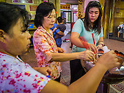06 FEBRUARY 2014 - HAT YAI, SONGKHLA, THAILAND: Women pray during Lunar New Year in the Tong Sia Siang Tueng temple in Hat Yai. Hat Yai was originally settled by Chinese immigrants and still has a large ethnic Chinese population. Chinese holidays, especially Lunar New Year (Tet) and the Vegetarian Festival are important citywide holidays.     PHOTO BY JACK KURTZ