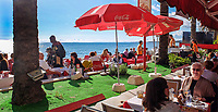 Guests dining at a chiringuito, open-air beach restaurant, specialising in fish especially sardines and seabass for clients in Marbella, Malaga, Spain, Espana. Big attraction is that the fish are cooked in the open-air over a wood-burning grill. 201412150203<br /> <br /> Copyright Image from Victor Patterson, Belfast, UK<br /> <br /> t: +44 28 9066 1296 (from Rep of Ireland 048 9066 1296)<br /> m: +44 7802 353836<br /> <br /> victorpattersonbelfast@gmail.com<br /> <br /> www.victorpatterson.com OR <br /> www.images4media.com<br /> <br /> Please see my Terms and Conditions of Use at https://www.victorpatterson.com/page2<br /> It is IMPORTANT that you familiarise yourself with them.<br /> <br /> Images used on the Internet incur an additional cost and must be visibly watermarked i.e. © Victor Patterson within the body of the image and copyright metadata must not be deleted. Images used on the Internet have a size restriction of 4 kbs and are chargeable at rates available at victorpatterson.com.<br /> <br /> This image is only available for the use of the download recipient i.e. television station, newspaper, magazine, book publisher, etc, and must not be passed on to any third party. It is also downloaded on condition that each and every usage is notified within 7 days to victorpattersonbelfast@gmail.com.<br /> <br /> The right of Victor Patterson to be identified as the author is asserted in accordance with The Copyright Designs And Patents Act (1988). All moral rights are asserted.