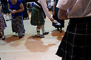 Talcum powered being spread on the dance floor at a St. Andrew's dinner dance held by the Sandbach and District Caledonian Society at Sandbach Town Hall, Cheshire, England on St. Andrew's Day. Around 40 people from the Society attended the meal and dance which included a programme of Scottish country dancing. St. Andrew was the patron saint of Scotland and the day was celebrated by Scots worldwide on the 30th November.