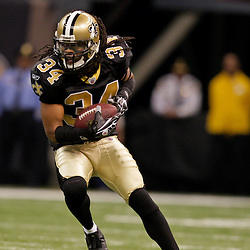 2009 November 30: New Orleans Saints cornerback Mike McKenzie (34) returns an interception against the New England Patriots during a 38-17 win by the New Orleans Saints over the New England Patriots at the Louisiana Superdome in New Orleans, Louisiana.