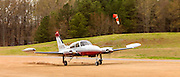 A Cessna 310 departing Stoney Point Airfield in Cumming, Ga.