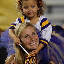 September 10, 2011; Baton Rouge, LA, USA;  A young LSU Tigers fan sits on the shoulders of her mom during the second half against the Northwestern State Demons at Tiger Stadium. LSU defeat Northwestern State 49-3. Mandatory Credit: Derick E. Hingle