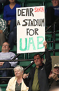 Dec 07, 2011; Birmingham, AL, USA; UAB Blazers fan holds up a sign asking Santa for a football stadium the Uab Blazers game against the Middle Tennessee Blue Raiders game. The board of trustees shot it down a couple of weeks ago. The Blazers defeated the Blue Raiders 66-56Mandatory Credit: Marvin Gentry-