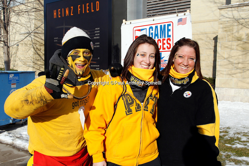 Pittsburgh Steelers fans with face paint pose for a photo before the NFL 2011 AFC Championship playoff football game against the New York Jets on Sunday, January 23, 2011 in Pittsburgh, Pennsylvania. The Steelers won the game 24-19. (©Paul Anthony Spinelli)