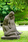 Stone statue of a loving couple at the National Opera Gardens, Riga, Latvia