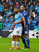 Sergio Aguero (10) of Manchester City gets some close attention from Greg Cunningham (18) of Cardiff City during the Premier League match between Cardiff City and Manchester City at the Cardiff City Stadium, Cardiff, Wales on 22 September 2018.