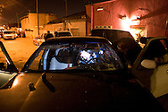 .Mexican investigators work in the scene of an assassination in Juarez Mexico..Sunday December 21,2008.