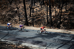 Anna Henderson (GBR) and Tiffany Cromwell (AUS) speed through the charred landscape at Stage 3 of 2020 Santos Women's Tour Down Under, a 109.1 km road race from Nairne to Stirling, Australia on January 18, 2020. Photo by Sean Robinson/velofocus.com