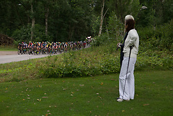 Golf players watch the race to pass their local golf course in the first short lap of the Crescent Vargarda - a 152 km road race, starting and finishing in Vargarda on August 13, 2017, in Vastra Gotaland, Sweden. (Photo by Balint Hamvas/Velofocus.com)