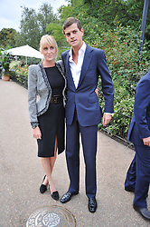 LADY EMILY COMPTON and the HON.ALEXANDER SPENCER-CHURCHILL at the unveiling of 'Isis' a sculpture by Simon Gudgeon hosted by the Royal Parks Foundation and the Halcyon Gallery by the banks of The Serpentine, Hyde Park, London on 7th September 2009.