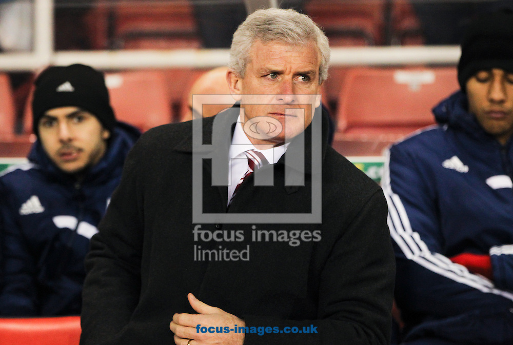 Stoke City manager Mark Hughes during the Barclays Premier League match at the Britannia Stadium, Stoke-on-Trent<br /> Picture by Tom Smith/Focus Images Ltd 07545141164<br /> 12/02/2014