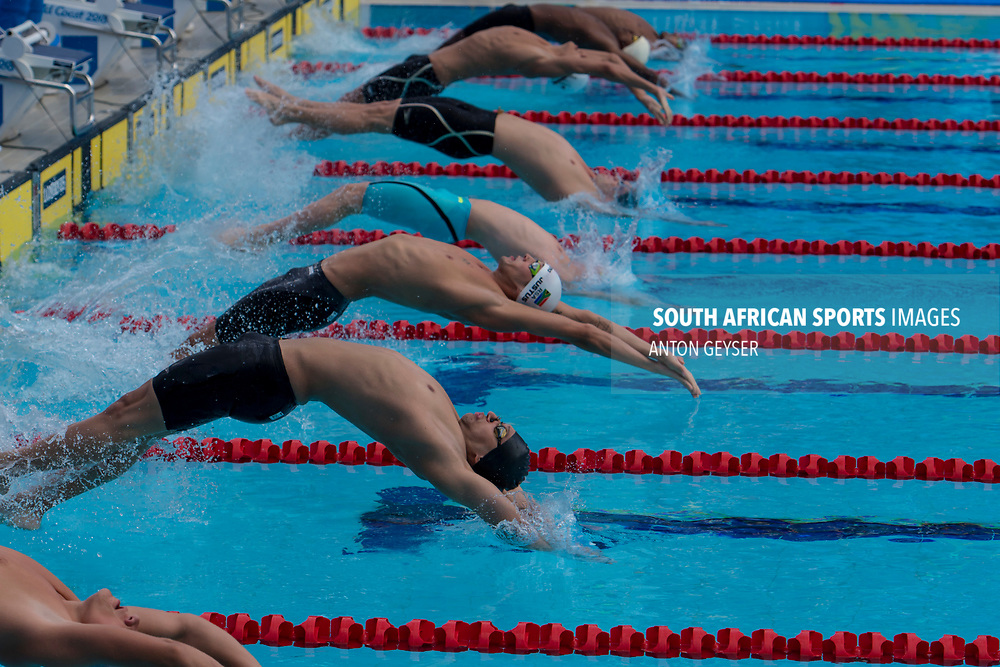 GOLD COAST, AUSTRALIA - APRIL 05: Calvyn Justus from South Africa in action in the Men's 100m Backstroke during day 1 of the Gold Coast 2018 Commonwealth Games at on April 05, 2018 in Gold Coast, Australia. (Photo by Anton Geyser)