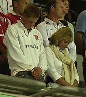Photo: Richard Lane.<br />England v Wales.  Quarter-Final 2, at the Suncorp Stadium, Brisbane. RWC 2003. 09/11/2003.<br />Prince Harry and Jayne Woodward during the minutes silence for Rememberance Sunday.