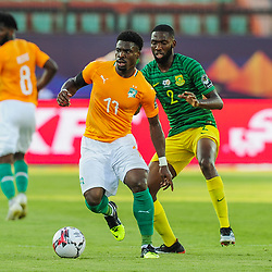 Serge Aurier of Ivory Coast is challenged by Buhle Mkhwanazi of South Africa during the 2019 Africa Cup of Nations Finals game between Ivory Coast and South Africa at Al Salam Stadium in Cairo, Egypt on 24 June 2019  <br /> Photo : Icon Sport