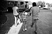 OT_282486_LYTT_LDDANI<br /> <br /> CAPTION:  (TAMPA, FL -- 02/03/2008) As a show of family togetherness and security, Diane Lierow, left, and her husband Bernie both hold one of Dani's hands as they walk her to the school bus on a weekday morning. (MELISSA LYTTLE | Times)<br /> <br /> STORY SUMMARY:  For the first seven years of her life, Danielle never saw the sun, felt the wind or tasted solid food.  She was kept in a closet in a Plant City apartment, cloistered in darkness, left in a dirty diaper, fed only with a bottle. &quot;She was a ferral child,&quot; said Carolyn Eastman of the Tampa heart Gallery. &quot;We'd never seen a case like that.&quot;