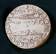 Obverse of medal commemorating the bright comet of 1577. Known as Brahe's comet, this is the comet which convinced the Danish astronomer Tycho or Tyge Brahe (1546-1601) that there is change beyond the sphere of the Moon. It is shown in his system of the universe published in his 'Mundi aetherei recentioribus Phaenomensis', (1588).