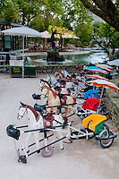 Barbe a papa horse buggies for children to ride in a park in Avignon, France.