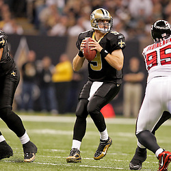 2009 November 02: New Orleans Saints quarterback Drew Brees (9) looks to throw against the Atlanta Falcons during a game at the Louisiana Superdome in New Orleans, Louisiana.
