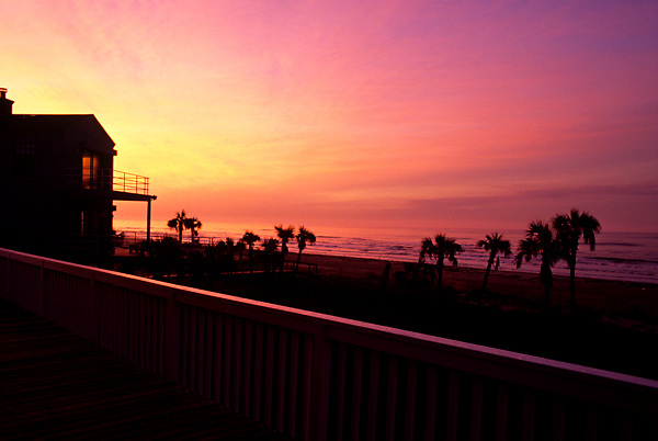 Colorful sunset along a Galveston Beach resort