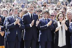 © Licensed to London News Pictures. 18/08/2017. Barcelona, Spain. President of Spain Mariano Rajoy Brey and KING Felipe VI of Spain join other officials and members of the public at a commemoration held at Las Ramblas in Barcelona for those who lost their life in yesterday's terror attack in Barcelona. 13 people were killed and dozens injured after van crashes into crowds. Photo credit: Victor Serri/LNP