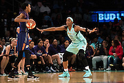 Swin Cash #32 of the New York Liberty defends against DeWanna Bonner #24 of the Phoenix Mercury during the second round of the WNBA Playoffs at Madison Square Garden in New York on September 24, 2016. (Cooper Neill for The New York Times)