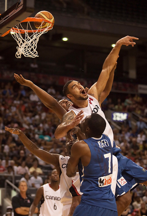 GJR503.jpg -20100812- Toronto, Ontario,Canada<br /> Canada's Robert Sacre collides with France's Boris Diaw (back) during a game in the 2010 Jack Donohue International Classic tournament in Toronto, Canada, August 12, 2010. Canada defeated France 69-58.<br /> AFP PHOTO/Geoff Robins