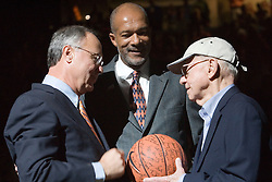 UVA President John Casteen (left) and Atheltics Director Craig Littlepage (center) present the final game ball from University Hall to John Paul Jones at the opening of the John Paul Jones Arena.  UVA defeated the #10 ranked Wildcats 93-90 in the first game at the new John Paul Jones Arena, in Charlottesville, VA on November 12, 2006...