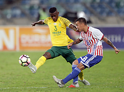 20112018 (Durban)<br /> Paraguay player Alejandro Gamarra and Bafana player Innocent Maela tackling for a ball during a match were Bafana Bafana and Paraguay have drawn 1-1 in the Nelson Mandela Challenge match played at Moses Mabhida Stadium in Durban on Tuesday evening.<br /> Picture: Motshwari Mofokeng/African News Agency (ANA)