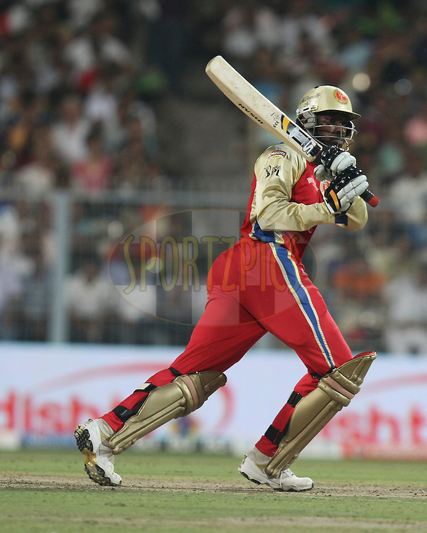 Chris Gayles of Royal Challengers Bangalore plays a shot  during match 24 of the Indian Premier League ( IPL ) between the Kolkata Knight Riders and the Royal Challengers Bangalore held at Eden Gardens Cricket Stadium in Kolkata, India on the 22nd April 2011...Photo by Parth Sanyal/BCCI/SPORTZPICS