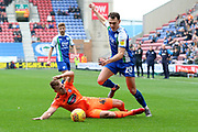 Wigan's Kal Naismith beats Ipswich Town's James Bree during the EFL Sky Bet Championship match between Wigan Athletic and Ipswich Town at the DW Stadium, Wigan, England on 23 February 2019.