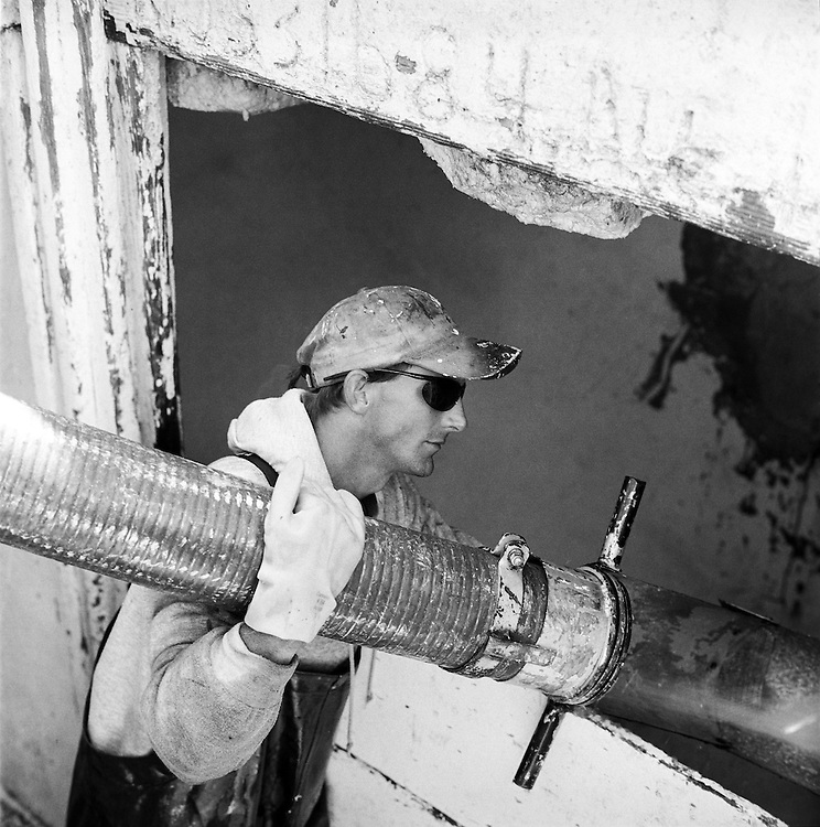 Striker Jamie, fills the hold of the Lady Eva at the Charleston Maritime Center | 2003