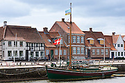 Evert ship Johanne Dan and riverfront houses in Skibbroen by Ribe River in medieval Ribe centre, South Jutland, Denmark