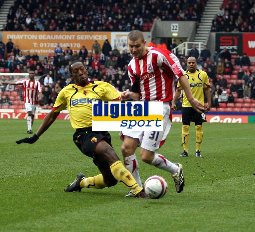 Photo: Mark Stephenson/Sportsbeat Images.<br /> Stoke City v Watford. Coca Cola Championship. 09/12/2007.Stoke's Carl Dickinson clashes with Watford's Lloyd Doyley