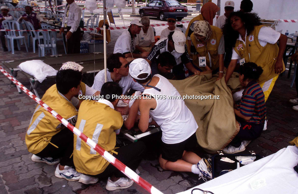 New Zealand walker Craig Barrett after collapsing at the Commonwealth Games, Kuala Lumpur, Malaysia, 1998. Photo: PHOTOSPORT *** Local Caption ***