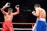 Amir Khan taunts a battered and bloody Marco Antonio Barrera during the WBA and WBO Inter-Continental Lightweight title fight between Amir Khan and Marc Antonio Barrera at the MEN Arena on March 14, 2009 in Manchester, England. during the WBA and WBO Inter-Continental Lightweight title fight between Amir Khan and Marc Antonio Barrera at the MEN Arena on March 14, 2009 in Manchester, England.
