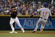 Aug 12, 2017; Phoenix, AZ, USA; Arizona Diamondbacks infielder Ketel Marte (4) is unable to make the force out on Chicago Cubs infielder Kris Bryant (17) in the first inning at Chase Field. Mandatory Credit: Jennifer Stewart-USA TODAY Sports