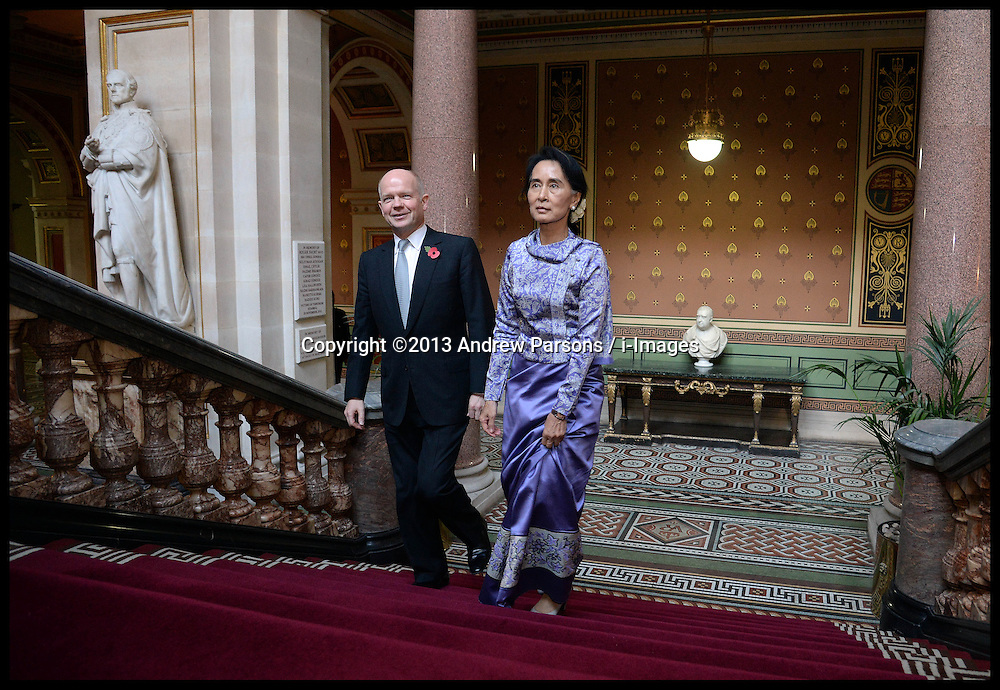Aung San Suu Kyi with the Foreign Secretary William Hague as she visits the Foreign Office as part of her visit to  London, United Kingdom. Wednesday, 23rd October 2013. Picture by Andrew Parsons / i-Images
