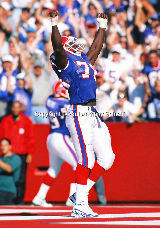 Buffalo Bills defensive end Bruce Smith (78) raises his arms in celebration during the NFL football game against the Detroit Lions on Oct. 5, 1997 in Orchard Park, N.Y. The Bills won the game 22-13. (©Paul Anthony Spinelli)