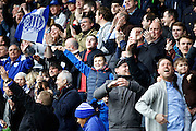 QPR fans celebrates the late winning goal during the Sky Bet Championship match between Queens Park Rangers and Charlton Athletic at the Loftus Road Stadium, London, England on 9 April 2016. Photo by Andy Walter.