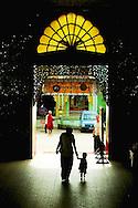 Mother and son entering Botataung pagoda at Yangon